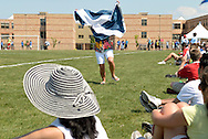A woman supporting a Scottish boys' soccer team celebrates a goal in front of a crowd at the International Children's Games in Windsor. Ontario.