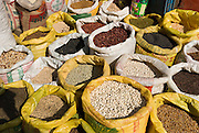 Yellow sacks hold beans and lentils for sale at a street market in Kathmandu, the largest city in Nepal (700,000 people).