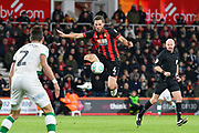 Dan Gosling (4) of AFC Bournemouth leaps in the air to control the ball during the EFL Cup 4th round match between Bournemouth and Norwich City at the Vitality Stadium, Bournemouth, England on 30 October 2018.