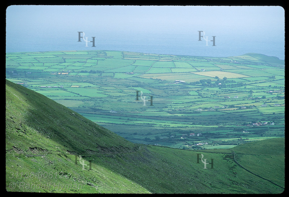 View from overlook above Conor Pass, Ireland's highest (1500'), of pastures along Dingle Bay. Ireland