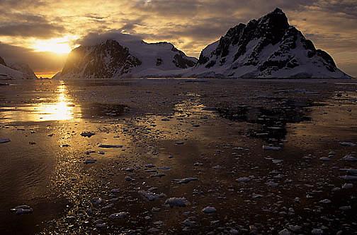 Antarctica, Sun setting over Lemaire Channel. Antarctica Peninsula.