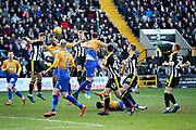 A rare Mansfield cross is dealt with by the Notts County defence during the EFL Sky Bet League 2 match between Notts County and Mansfield Town at Meadow Lane, Nottingham, England on 16 February 2019.