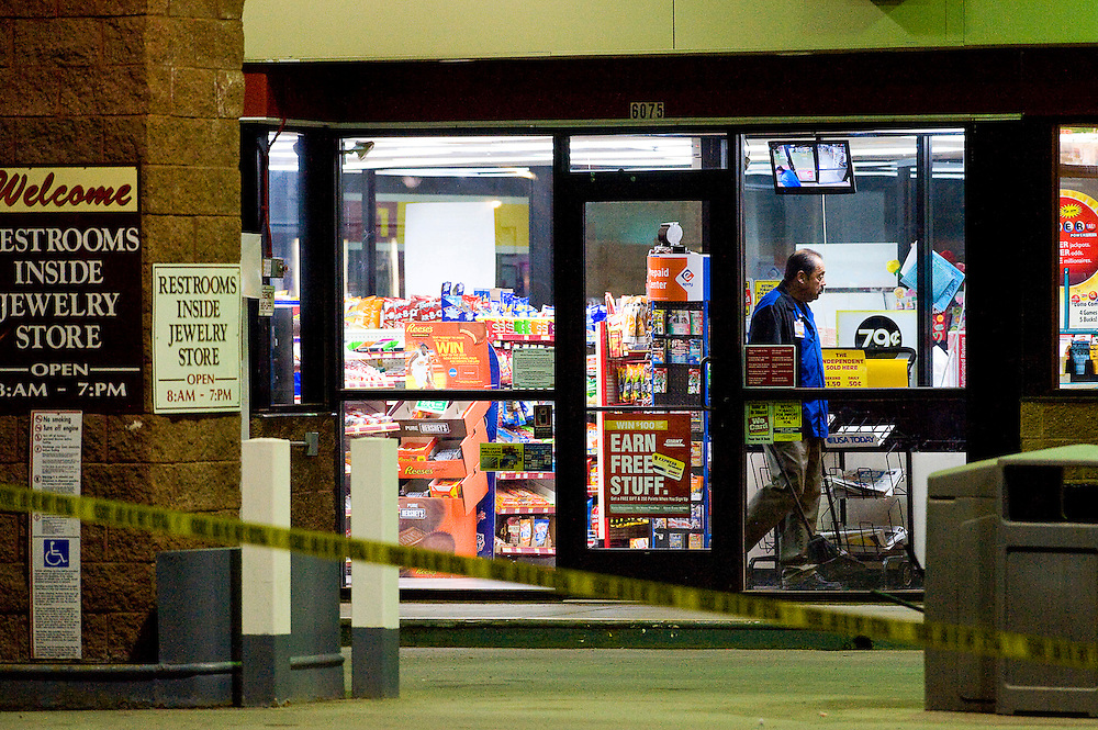 031212     Brian Leddy.An employee at the Shell gas station on the east side of Gallup works inside the store Monday evening as police investigate a shooting that occurred outside of the store. Several people were reported injured in  a series of shootings that occurred in various locations in Gallup.