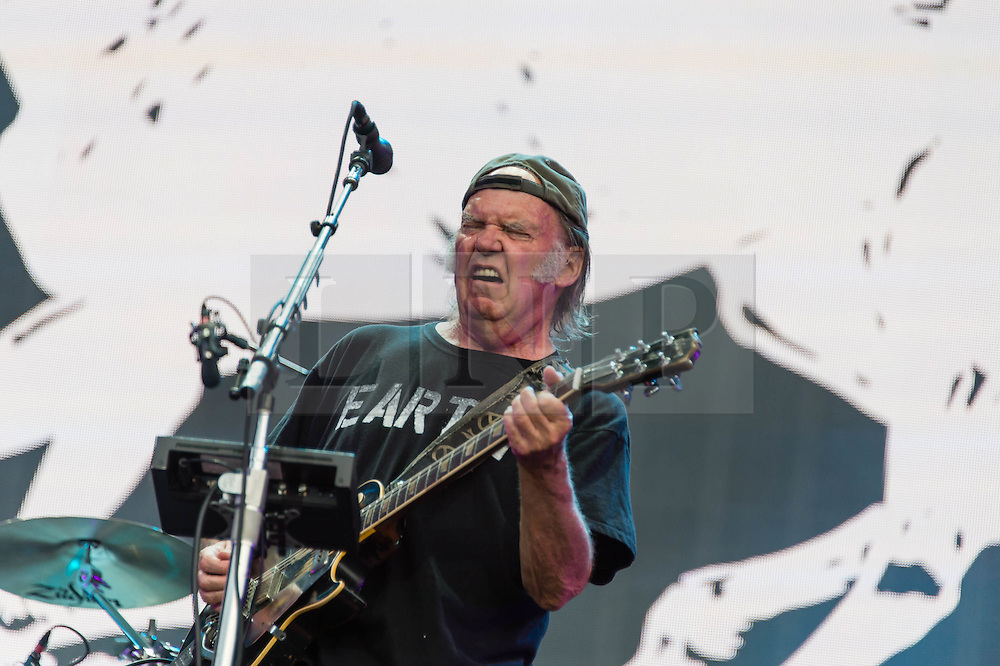 """© Licensed to London News Pictures. 12/07/2014. London, UK.   Neil Young and Crazy Horse performing live at Hyde Park as part of the British Summer Time series of outdoor concerts.   Crazy Horse is a rock band long associated with Neil Young,  consisting of members Rick Roses, (bass, vocals), Ralph Molina (drums, vocals), Frank """"Poncho"""" Sampedro ( guitar, organ, keyboards).  Photo credit : Richard Isaac/LNP"""