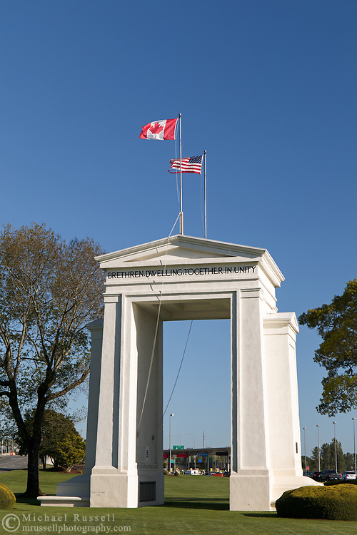 "The Peace Arch (1921) looking towards the USA.  Photographed from Peace Arch Provincial Park in Surrey, British Columbia, Canada.  The Peace Arch was built in 1921 to commemorate the 100 year anniversary of treaties at the end of the War of 1812 between the USA and Great Britain. One side states ""Children Of A Common Motherr"", the other ""Brethren Dwelling Together In Unity""."