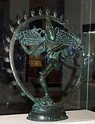 Hindu god Shiva appears as Nataraja (lord of the dance) dancing in a ring of fire. In his hair is a small representation of the goddess Ganga.  Bronze figure of Nataraja, Tamil Nadu, southern India, Chola dynasty, c1100.  Mythology