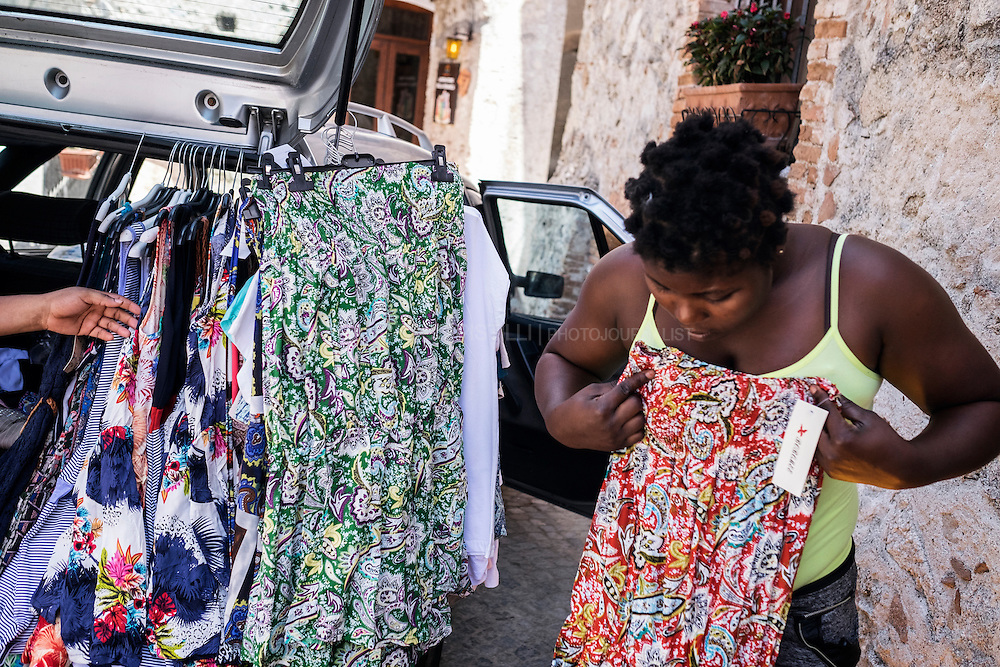 A Nigerian woman during shopping for new clothes. RIACE (ITALY) 01/08/16