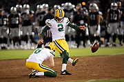 Green Bay Packers rookie punter JK Scott (6) holds while Green Bay Packers kicker Mason Crosby (2) kicks a 42 yard field goal that ties the first quarter score at 3-3 during the 2018 NFL preseason week 3 football game against the Oakland Raiders on Friday, Aug. 24, 2018 in Oakland, Calif. The Raiders won the game 13-6. (©Paul Anthony Spinelli)