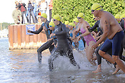 The first group of competitors start the swimming leg of the inaugural Little Traverse Triathalon in Harbor Springs, Michigan.