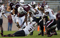 Texas A&M running back Trayveon Williams (5) is knocked off his feet by South Carolina defensive back Chris Lammons (3) during the first quarter of an NCAA college football game Saturday, Sept. 30, 2017, in College Station, Texas. (AP Photo/Sam Craft)