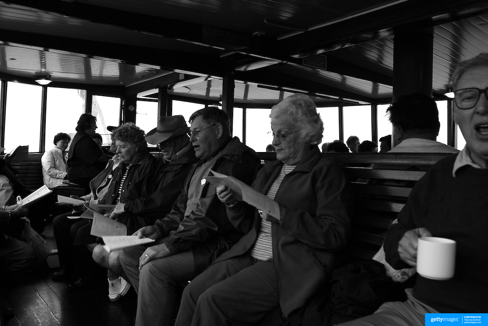 Passengers enjoy a good old fashioned singalong while sailing on the Steamship TSS Earnslaw on Lake Wakatipu, South Island, New Zealand...You would be forgiven for thinking you'd just stepped out of a time machine while travelling around the South Island of New Zealand.. From the misty shades of grey in the fiord of Doubtful Sound, to the fully operational Steamboat the TSS Earnslaw; the Lady of the Lake on Lake Wakitepo, this beautiful island is a Tardis for tourists!..The South Island of New Zealand is roughly the size of England, but it's population of less than a million people means much of the land remains free from human development. It's breathtaking views, and it's climate, could be likened to a cross between Scotland and Scandinavia, and around every corner is mostly unspoilt natural beauty....The Commercialised resort town of Queenstown is the nerve centre of the islands tourism industry, providing the more adventurous thrill seeker with jet boating, skydiving, bungy jumping, and paragliding to name just a few of the more adventurous activities..Queenstown also provides numerous Lord of the Rings tours into middle earth.. In stark contrast the TSS Earnslaw, The Vintage Steamship which has graced the waters of Lake Wakatipu since 1912 provides daily voyages to Walters Peak and a step back in time for it's passengers. The voyage even includes a good old fashion sing-a-long to songs of yesteryear...Just forty five minutes out of Queenstown the Kingston Flyer, a vintage steam train still operates on 14km of track using two AB Pacific Class steam locomotives built in 1925 and 1927 respectively, although the Flyer's history began much earlier in 1878 when it operated between the main south line and Gore..Fijordland on the south Western side of the Island has some of the world's greatest treks; indeed the Milford Track is often booked up way in advance...