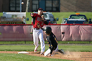 Greece Athena's Mike Ruta slides into second base as Hilton's Jake Bodamer throws to first to complete the double play during a game in Hilton on Wednesday, April 27, 2016.