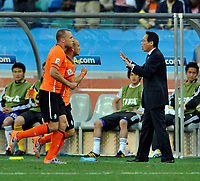 Durban World Cup 2010  Holland v Japan  Match 25 19/06/10<br /> Wesley Sneijder   (NED) is congratulated by  Nigel de Jong after first goal as Japanese  manager Takeshi Okada surrenders <br /> Photo Roger Parker Fotosports International