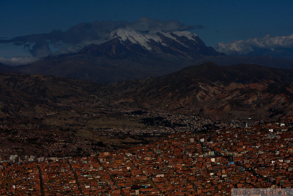 Aerial view of the snow capped mountain Illimani near La Paz, Bolivia, Wednesday, April 28, 2010. Several indigenous communities in the south of the city rely for the farming that feeds the capital on the river streams supplied by a regulated pattern of rain, snow and melting that seems to be unbalanced nowadays.