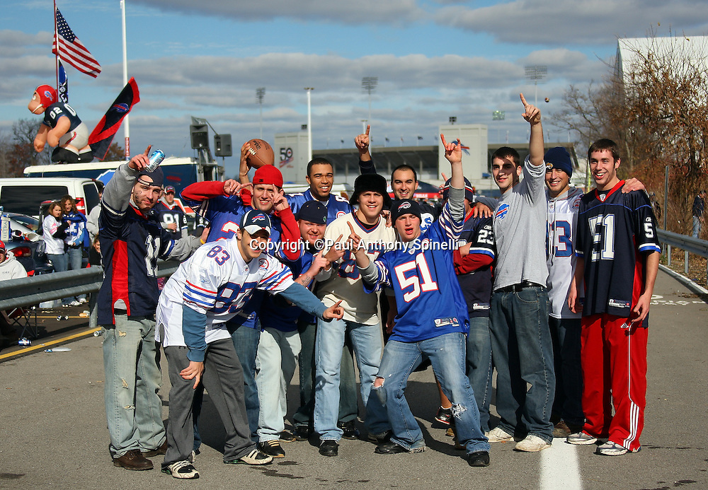 Buffalo Bills fans take a break to cheer for their team while tailgating in the parking lot before the NFL football game against the Houston Texans, November 1, 2009 in Orchard Park, New York. The Texans won the game 31-10. (©Paul Anthony Spinelli)