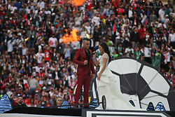 June 14, 2018 - Moscow, Russia - Russian Federation. Moscow. The Luzhniki Stadium. Match Opening of the World Cup 2018. Russia - Saudi Arabia. Solemn opening ceremony of the FIFA World Cup 2018. FIFA World Cup 2018. Player of the Russian national football team (in red)..Robbie Williams; Aida Garifullina. (Credit Image: © Russian Look via ZUMA Wire)