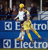 Photo: Kevin Poolman.<br />Luton Town v Derby County. Coca Cola Championship. 18/11/2006. Ahmet Brkovis (left) of Luton and Marc Edworthy of Derby both go up for a header.
