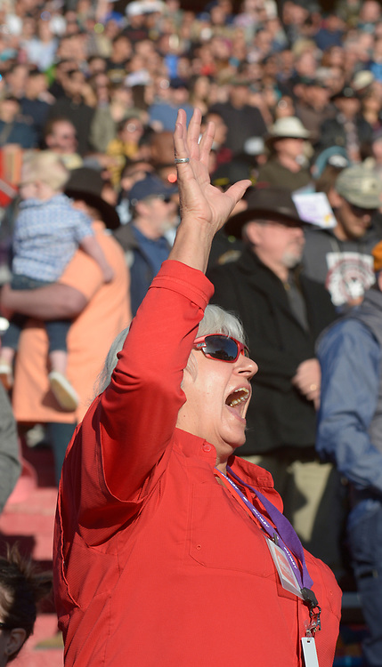 gbs041617e/ASEC -- Thamer Vann of Albuquerque raises her hand in praise during a song at the Calvary Albuquerque's  Easter Sunrise Service: Against All Odds on Sunday, April 16, 2017. (Greg Sorber/Albuquerque Journal)