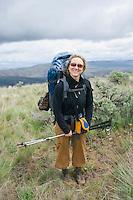 Portrait of a female backpacker in the high desert of Umptanum Ridge eastern Washington USA&#xA;<br />