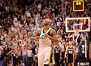 Jazz guard Mo Williams takes off downcourt after making the game winning 3-pointer during the second half of the NBA basketball game between the Utah Jazz and the San Antonio Spurs at Energy Solutions Arena, Wednesday, Dec. 12, 2012.