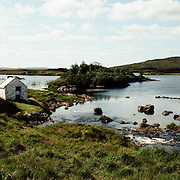 A rural scene in the Irish countryside showing an old farm buidiing Connemara, County Galway. Ireland. 23rd July 2011. Photo Tim Clayton
