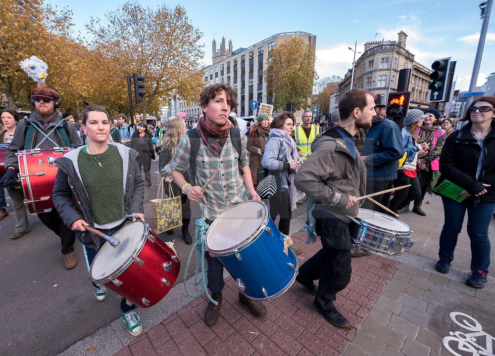 © Licensed to London News Pictures. 12/11/2018. Bristol, UK. Activists block the roads and a petrol station in central Bristol as part of the 'Extinction Rebellion' campaign about the threat of climate change. The Extinction Rebellion campaign wants to make ecocide a crime in UK law, saying the threat of climate change threatens the lives of millions of people on the planet. The campaign is organised by Rising Up, and follows the Intergovernmental Panel on Climate Change (IPCC) issuing a special report last month on the impact of global warming of 1.5C and above. The campaign says there will be more actions across the UK in November. Photo credit: Simon Chapman/LNP