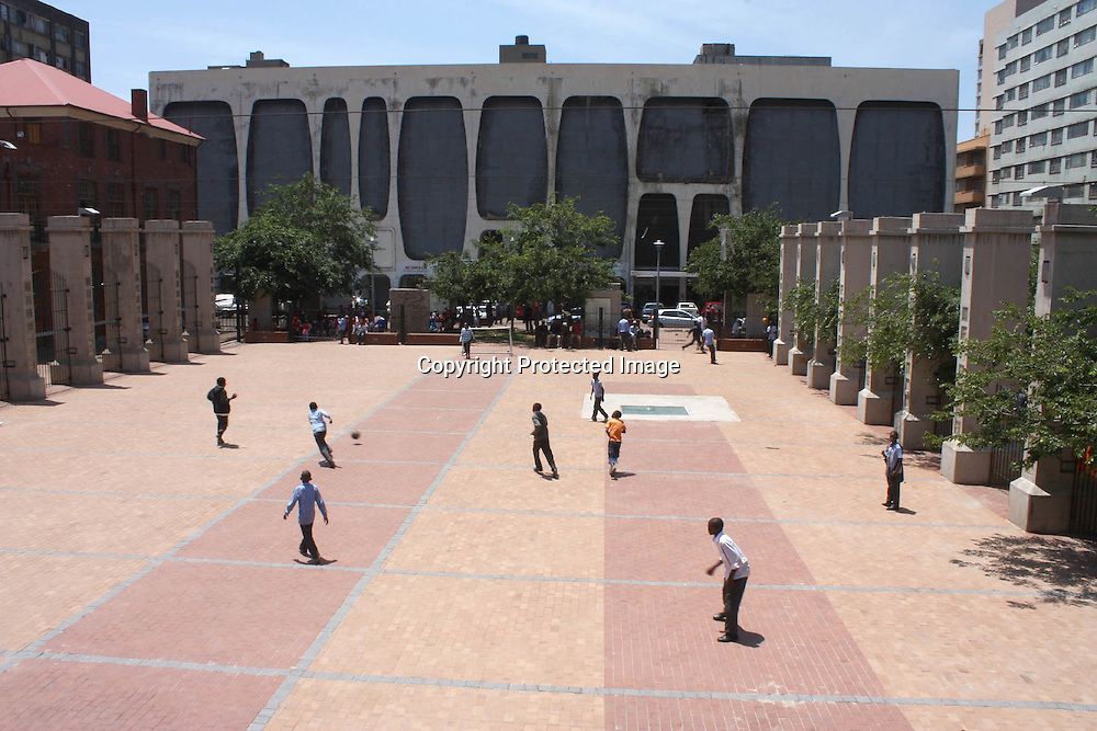 """An ariel view of the drill hall in downtown Johannesburg on 23 October 2009. Children from the inner city schools and more recently street kids use the space to play soccer. Despite the concrete surface and the small space, the children are enthusiastic and energetic as they play.  According to the UN Convention on the Rights of the Child children have the """"right to engage in play and recreational activities."""" The Johannesburg Child Welfare in partnership with ' A Chance to Play'; a project supported by the Volkswagen Group Works council Society work together to ensure that children engage in some form of play."""