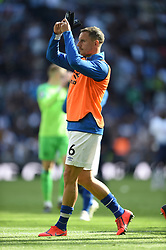 Everton's Phil Jagielka applauds the away fans at full time