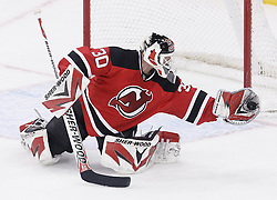 Jan 29, 2010; Newark, NJ, USA; New Jersey Devils goalie Martin Brodeur (30) makes a glove save during the third period at the Prudential Center. The Devils won 5-4 in overtime.