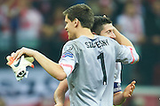 Poland's Robert Lewandowski (R) and Poland's goalkeeper Wojciech Szczesny celebrates after victory during the EURO 2016 qualifying match between Poland and Germany on October 11, 2014 at the National stadium in Warsaw, Poland<br /> <br /> Picture also available in RAW (NEF) or TIFF format on special request.<br /> <br /> For editorial use only. Any commercial or promotional use requires permission.<br /> <br /> Mandatory credit:<br /> Photo by &copy; Adam Nurkiewicz / Mediasport