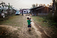 An early morning scene in Khon Kahndone Village, before the JE vaccine campaign.