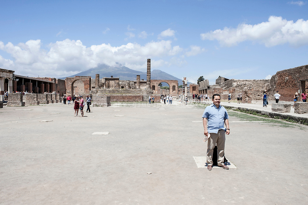"20 May 2017, Pompei, Naples Italy - A tourist posing for a photo memory inside the ""Forum"" of ancient city of Pompeii."