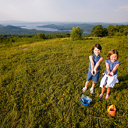 Girls showing off the blueberries they picked on a hilltop in Alton, New Hampshire.