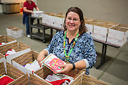 Michelle Eacret poses for a portrait while putting the final touches into 50 boxes Holiday Cards created special for the U.S. Military during the Girl Scout USA of Northern California Operation Holiday Cards packing event at Mount Olive Ministries in Milpitas, California, on November 18, 2015. (Stan Olszewski/SOSKIphoto)