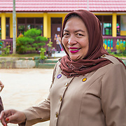 CAPTION: Mrs Iraniati talks about the changes she has noticed in her students' behaviour since learning about climate change in school. She says they are eager to separate waste and save electricity, and that they are keen to build more biopores, not only at school but also at home. LOCATION: SDN 1 School, Langkapura, Bandar Lampung, Indonesia. INDIVIDUAL(S) PHOTOGRAPHED: Mrs Iraniati.