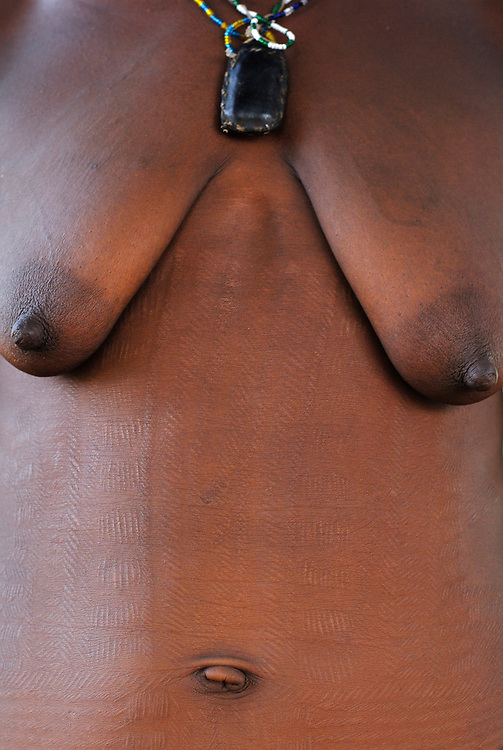 Benin, Natitingou April 22, 2005 - Woman with scarifications on her body. These scarifications represent the passage at the adulthood