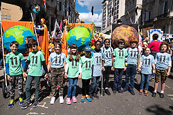 © Licensed to London News Pictures. 12/05/2019. London, UK. 11 Children stand at the front of the 'Mothers Rise Up' climate change demonstration in central London, calling for urgent action on climate change. The 11 children represent the 11-year window needed to act on climate change. The demonstration started at Hyde Park Corner and finished in Parliament Square. Photo credit : Tom Nicholson/LNP