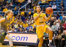 Jan 30, 2016; Morgantown, WV, USA; West Virginia Mountaineers guard Chania Ray (12) shoots a layup during the first quarter against the Baylor Bears at WVU Coliseum. Mandatory Credit: Ben Queen-USA TODAY Sports
