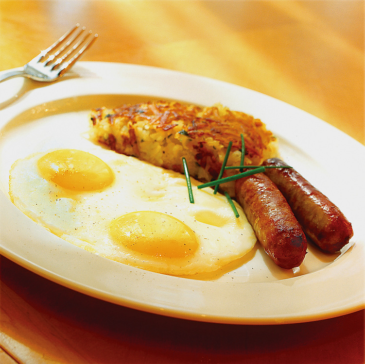 eggs sunny side up with sausages,hash browns,food photographer,miami,<br />