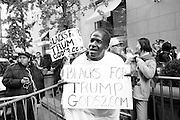 An African American supporter of Donald J. Trump at a gathering on New York's Fifth Avenue in front of Trump Tower the Saturday before the November 2017 election