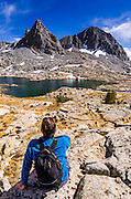 Hiker under Isosceles Peak in Dusy Basin, Kings Canyon National Park, California USA