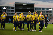 Liam Dawson of Hampshire leads off Hampshire after their win against Somerset during the NatWest T20 Blast South Group match between Hampshire County Cricket Club and Somerset County Cricket Club at the Ageas Bowl, Southampton, United Kingdom on 29 July 2016. Photo by David Vokes.