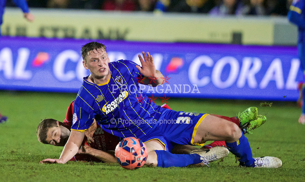 KINGSTON-UPON-THAMES, ENGLAND - Monday, January 5, 2015: Liverpool's captain Steven Gerrard in action against AFC Wimbledon's Jake Goodman during the FA Cup 3rd Round match at the Kingsmeadow Stadium. (Pic by David Rawcliffe/Propaganda)