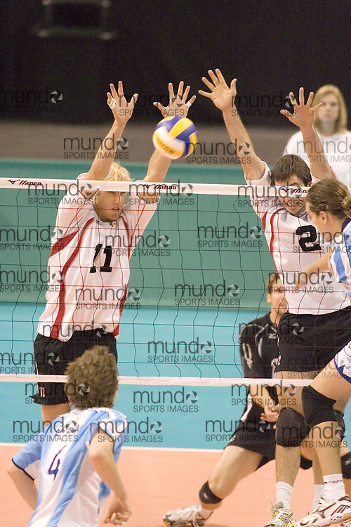Steve Brinkman (11) and Christian Bernier (2) of  Canada during a three games to none defeat of Argentina in the 2006 Anton Furlani Volleyball Cup, held in Ottawa, Canada. .Anton Furlani Cup.Copyright Sean Burges / Mundo Sport Images, 2006