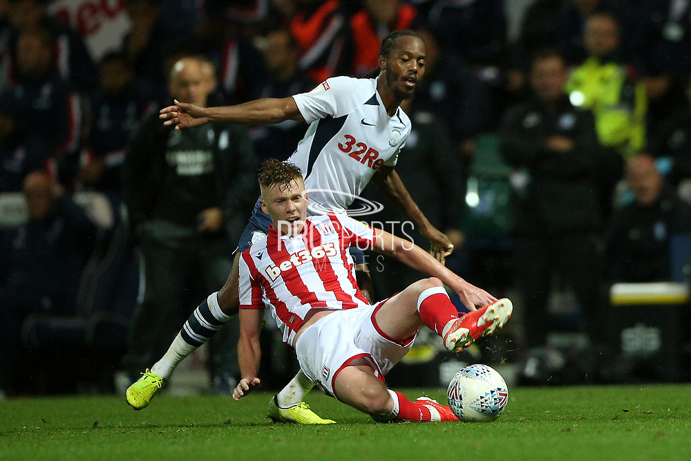 Stoke City midfielder Sam Clucas (22) and Preston North End midfielder Daniel Johnson (11) tangle during the EFL Sky Bet Championship match between Preston North End and Stoke City at Deepdale, Preston, England on 21 August 2019.