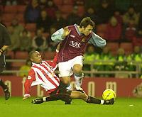 Photo. Glyn Thomas.<br /> Sunderland v Burnley. Nationwide Division 1.<br /> Stadium of Light, Sunderland. 29/11/03.<br /> Sunderland's Jeff Whitley (L) slides in to tackle Robbie Blake.