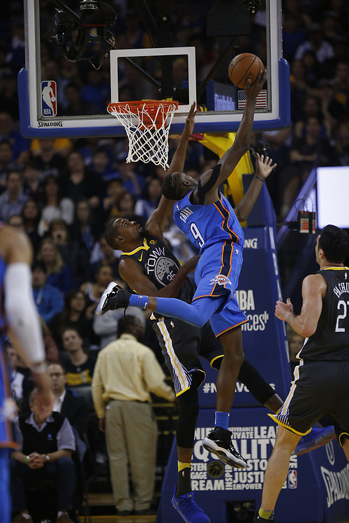Oklahoma City Thunder forward Jerami Grant (9) shoots against Golden State Warriors forward Kevin Durant (35) during the first half of an NBA game between the Warriors and Oklahoma City Thunder at Oracle Arena, Tuesday, Feb. 6, 2018, in Oakland, Calif.