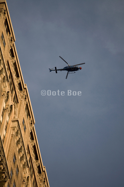 helicopter with a camera hovering over a New York cities high rise building