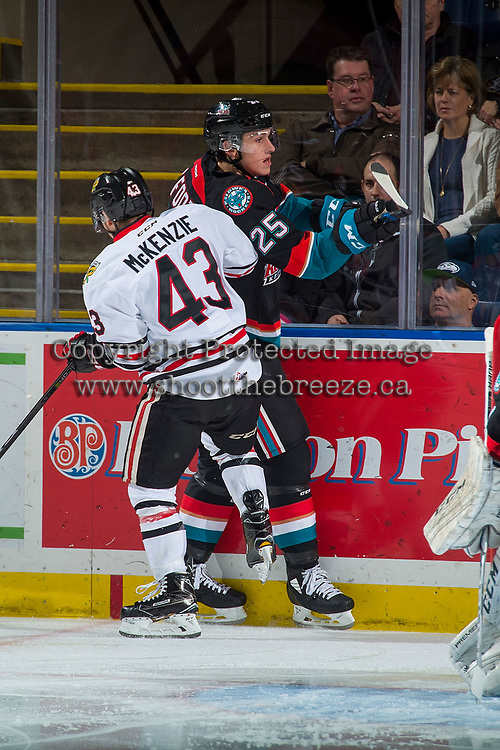 KELOWNA, CANADA - OCTOBER 20: Skyler McKenzie #43 of the Portland Winterhawks checks Cal Foote #25 of the Kelowna Rockets into the boards on October 20, 2017 at Prospera Place in Kelowna, British Columbia, Canada.  (Photo by Marissa Baecker/Shoot the Breeze)  *** Local Caption ***