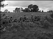 Army Exercises In Co Sligo.   (L37).<br /> 1977.<br /> 05.09.1977.<br /> 09.05.1977.<br /> 5th September 1977.<br /> The Army Reserve Brigade, which is made up of regular units from the Southern Command, are conducting a series of conventional military exercises in counties Mayo and Sligo from the 5th to the 9th September. Approximately 1,500 men and 250 vehicles are involved. The exercise was codenamed &quot;Humbert&quot; after an ill fated expedition by French troops into Ireland on 23rd August 1798. 1,100 French troops with Irish support took on the incumbent English forces. After some initial success they were defeated at Ballinamuk on 8th Sept 1798 by the army of Cornwallis.<br /> <br /> Members of the 4th Infantry batallion are pictured taking up defensive positions during the exercise.<br /> (L-R). Pte Wayne O'Connor,Pte Francis Wyse, Corp Dan Downey,Corp Paddy Hartnell, Pte Patrick Deasy,Pte Patrick Mahoney, Pte Colin O'Brien,Pte Gerry Fogarty,Pte Billy Collins, Pte Derry Hegarty and Corp Ger Sheehan.